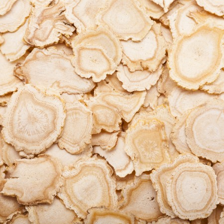 a shot of dry sliced ginseng background.